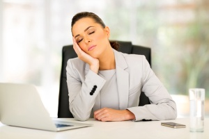 businesswoman sleeping in office